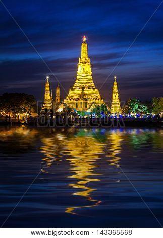 Night view of Wat Arun temple and Chao Phraya River Bangkok Thailand
