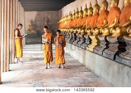 Thai Novices at temple in Ayutthaya Historical Park Thailand