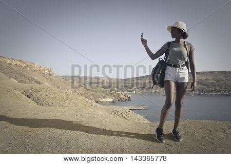 Taking pictures of a natural landscape