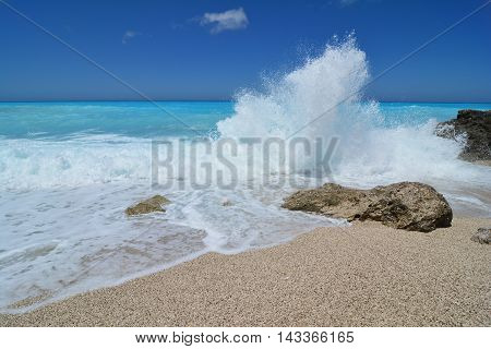 Big waves stones and splash clean turquoise water of very famous Kathisma beach Lefkada island Greece