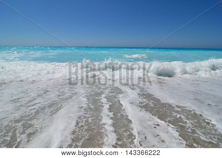 Big waves in a windy day and clean turquoise water of very famous Kathisma beach Lefkada island Greece