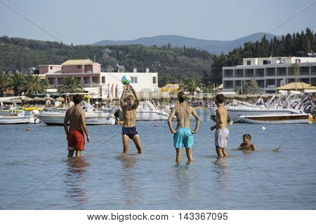 CORFU, GREECE - AUGUST 19, 2016: Young people at Sidari beach playing with ball in water