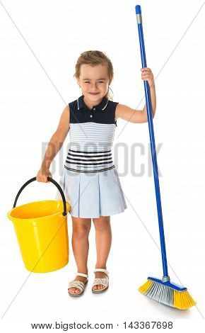 Diligent little girl is tidying up the apartment. In the hands of the girl holding a brush and bucket - Isolated on white background