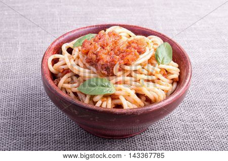 Small Portion Of Cooked Spaghetti In A Brown Small Wooden Bowl