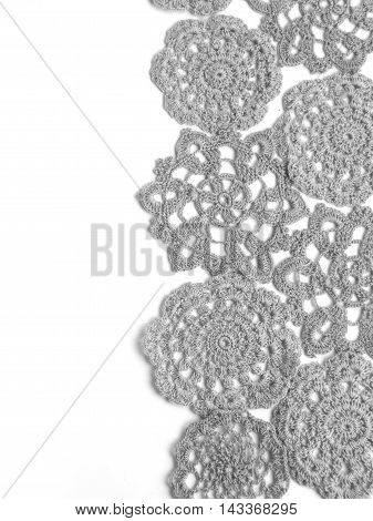 Handmade crochet lace in black and white shade  on white background