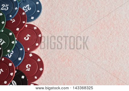 Poker chips forming a border on the left with a white background