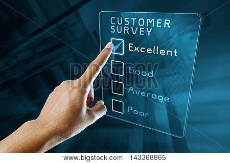 hand clicking online customer survey on virtual screen interface