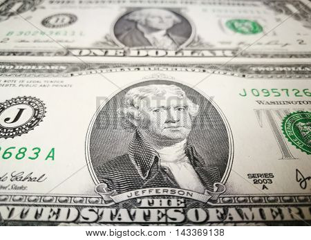 Close up of US dollar bank note with image of Jefferson and Washington. US money background.