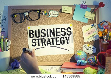 Business strategy concept with bulletin board in office