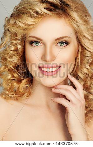 Perfect Girl. Blonde Woman smiling. Beautiful Face