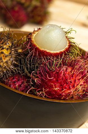 rambutan sweet delicious fruit On background wooden table