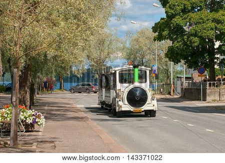 LAPPEENRANTA, FINLAND - AUGUST 8, 2016: Excursion Fun Train on the one of the streets near Saimaa Lake