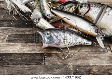 Rostov - on - Don, Russia - August 19, 2016: Fishing jig baits on wooden background. Macro shot.