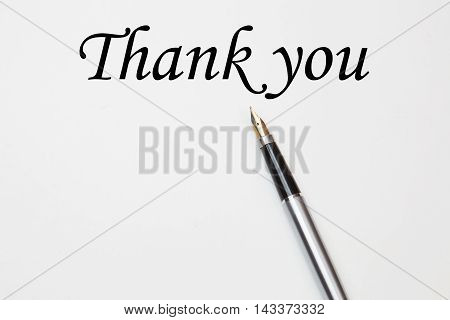 Fountain pen on thank you, isolated on white