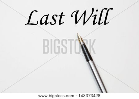 Pen on last will, isolated on white