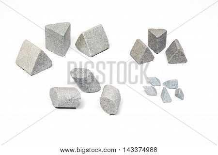 Sharpening stones sets in different shapes on white background