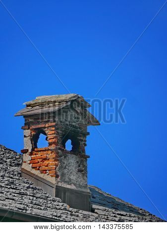 Old Italian chiemney on roof, made of stone shoot in Ticino, south of Swithzerland