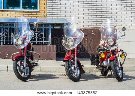 Three Java Motorcycle Retro Stand Against The Wall./xhibition Of Old Soviet Motorcycle Java Outdoors
