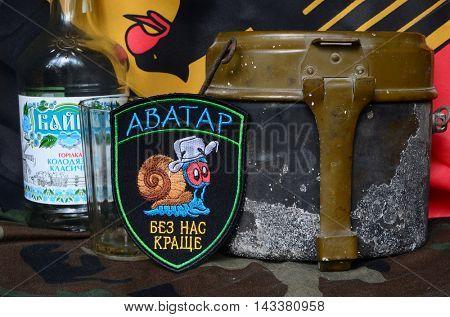 ILLUSTRATIVE EDITORIAL.Avatar.Chevron of Ukrainian army for alcohol addictive soldiers.German Flag as background.June 23,2016 in Kiev, Ukraine