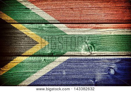 flag of the Republic of South Africa painted on old grungy wooden background: 3d illustration