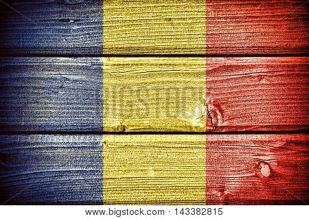 Flag of Romania painted on old grungy wooden background: 3 d illustration