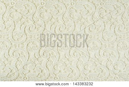 Closeup of white embroidered lace texture for background