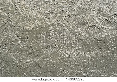 Closeup of carelessly painted gray wall for background