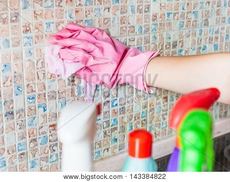Hand In Glove Washes Ceramic Tiles On Kitchen Wall