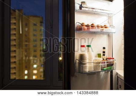 Door Of Home Fridge With Dairy Products In Night