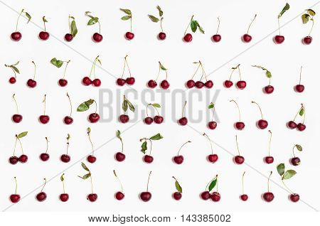 Set From Many Ripe Red Cherries Arranged On White