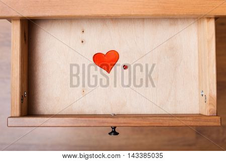 Little And Big Red Hearts In Open Drawer