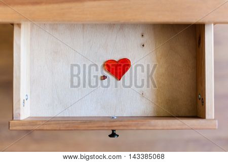 Little And Big Glass Hearts In Open Drawer