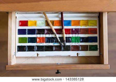Watercolor Paints Set And Brushes In Open Drawer