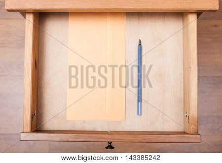 Blue Pen And Envelope In Open Drawer