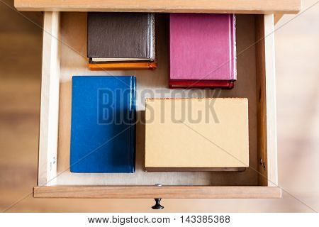 Several Little Books In Open Drawer