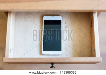 Smartphone In Open Drawer