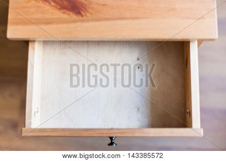 Empty Open Drawer Of Wooden Nightstand