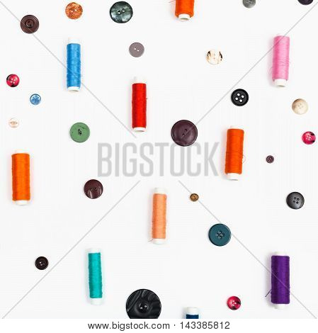 Spools Of Sewing Thread And Different Buttons
