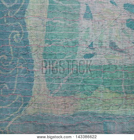 Clenched Green Silk Fabric And Batik On Background