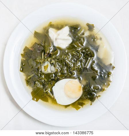 Above View Of Vegetarian Soup In Plate From Greens