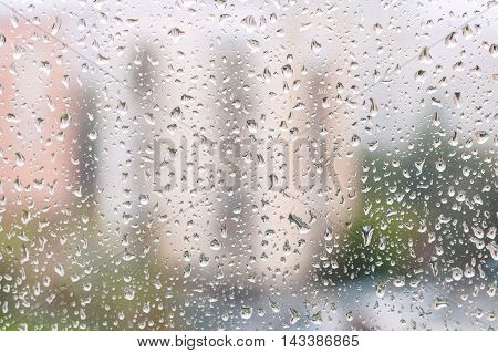 Iew Of Rain Drops On Window Pane Of Urban House