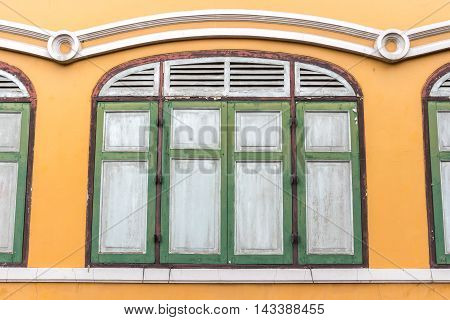 Vintage window on old public building in Bangkok, Thailand