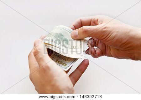 Hand holding money - United States dollar close up macro