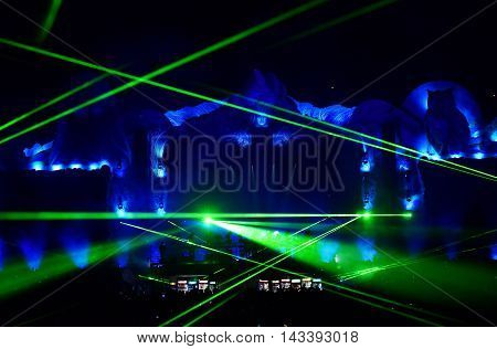 Dj Mixing Live On The Stage At A Music Festival