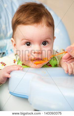 Very Little Kid Eats Fresh Tasty Nutritious Curds On Highchair