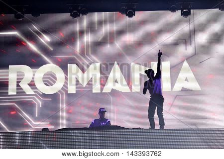 Dj Afrojack Mixing On The Stage