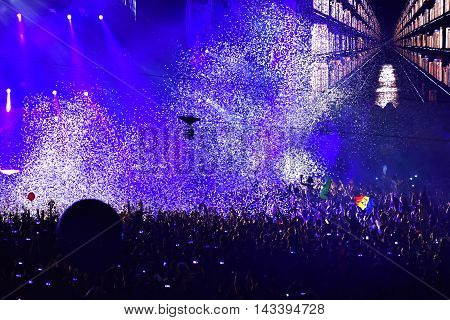Confetti Over Partying Crowd During A Live Concert
