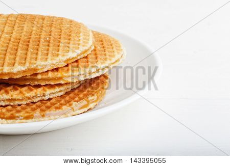 Closeup Round Wafers In A White Plate