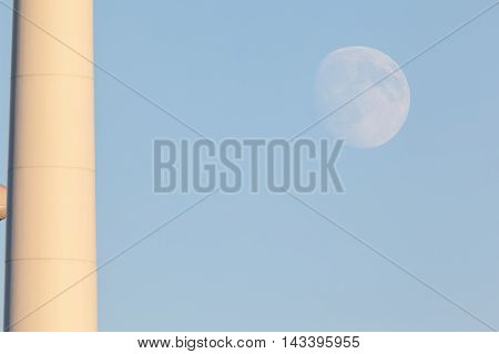 the moon with windmill close up in the sunset