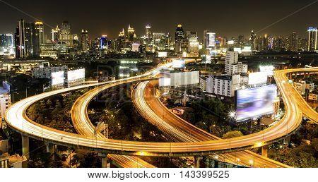 Arial view of Bangkok city with main traffic and express way at night